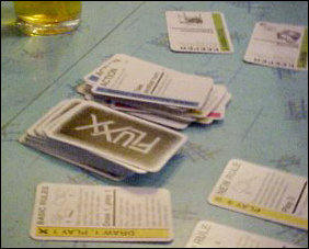 "When playing Fluxx, you have several different cards. Yellow ""new rule"" cards, which dictate new rules such as hand limits, keeper limits, card selection rules, etc., pink goal cards which determine a certain goal to reach to win the game, green ""keeper"" cards, and blue ""action"" cards. All rules and goals are subject to change at any time."