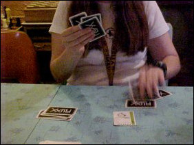 When Heather's looking for cards to play, she smacks the cards down on the table in record speed!
