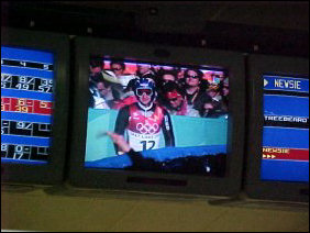 Meanwhile, while all this bowling is happening, the Salt Lake City Olympics are playing on the TV.