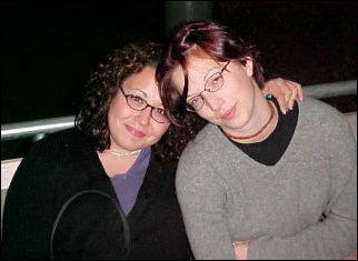 Kelley (left) and Beth... roommates and buddies. And, on a different occasion, quite the jokers (below).