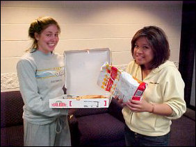 And later, Callie and Joanne enjoy pizza and potato chips.