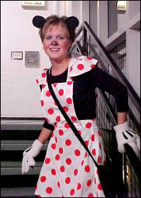 In the stairwell, I encountered none other than Minnie Mouse, complete with those trademark cartoon-character gloves.