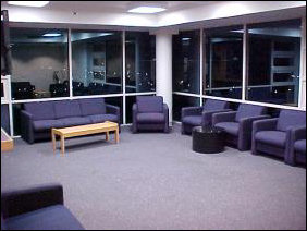 Welcome to the TV lounge! Color TV, now with 70+ channels, provided we have a coaxial cable hooked to the TV, adequate seating, and a view of the Harrisonburg skyline.