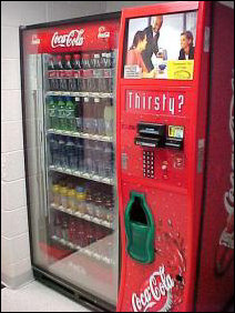 "On the freshman side, we have the ""cool"" vending machine, due to the conveyor belt that rises up, picks up your drink, then ferries it to the green receiver section, ready for you to enjoy it."