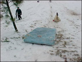 Meanwhile, other people tried to take a large blue mattress and use it for sledding. The raw mattress, unfortunately, did not work. It stopped, and sent its occupant on ahead.
