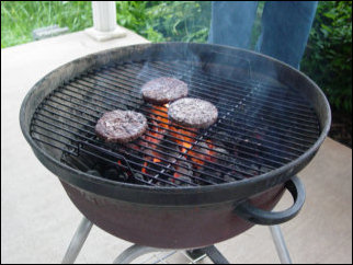 And more hamburgers cook on the grill...