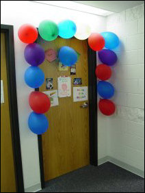 In celebration of a birthday, a door is decorated with balloons!