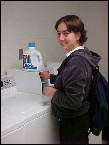 Christina knocks off a load of laundry before settling in for a Halloween study session.