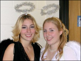 Aimee (at right) and her sister dressed up as an angel and a fallen angel.