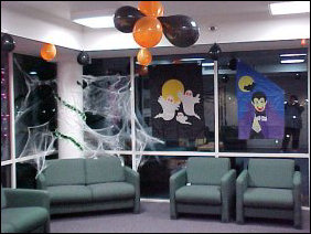 In the corner, we find more spider webs, as well as more balloons and festive decor - flags and stick-ons and such.
