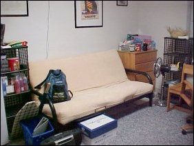 On the other side of the room, the futon is back in action, as well as the refrigerator and various supplies.