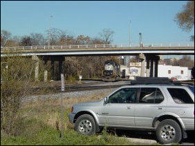Continuing along Chesapeake Avenue, we find more industrial area, and then passed over the railroad tracks, and under the Talmage R. Cooley bridge back to Grace Street.