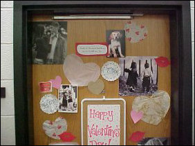 "This door is covered with pictures with major ""cute"" value, as well as paper hearts to perfectly complement the pictures."