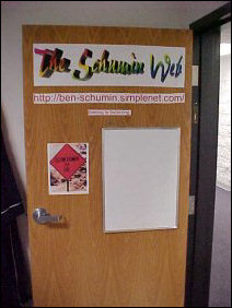 "Some things never change, as you can plainly see.  Site logo, in pretty colors on the door, address, and white-board.  A couple of differences, though... the picture is different, and my site's slogan (yes, I do have one) is there now.  Before I got my domain, it was ""Seeing is Believing"".  This was taken early on in our time at Potomac, judging by the SimpleNet URL on the door."