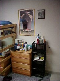 And this is my dresser, as well as storage space.  Note so many things that couldn't find a home got a home in Potomac... last year, that Normandie poster was sitting, in its frame, on the floor for most of the second semester.  Now, it hangs from the wall, like it should.