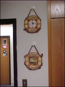As if there's not enough clocks and things, here's two more for ya... I picked these up at Virginia Beach in August, and so by the door is a clock and a mirror.  Made to look like Titanic life rings.  I don't really use the clock (I have a clock on my computer that I use), but I do shave in that little mirror.  Note one inaccuracy: Titanic's home port is not London - it's Liverpool.
