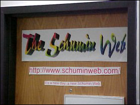 "As mentioned above, the door is similar to last year, but things changed since the first picture was taken.  For one thing, I got settled into www.schuminweb.com, and my new slogan, ""It's a new day, a new Schumin Web"" is on the door.  You can see a close-up of the top of the door below..."