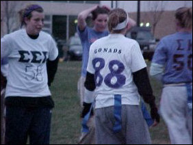 "The Tri-Sigma sisters definitely had a field day with their shirts!  Besides the ΣΣΣ letters, they put numbers and various words on the back of their shirts.  In the picture at left, above the large 88 is the word ""GONADS"".  At right, above the 04, ""FONTANA"" is written in block letters."