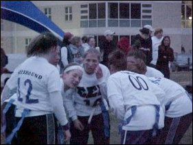 As with any football game, a huddle is necessary in order to communicate strategies to kick Sigma Kappa's butt.