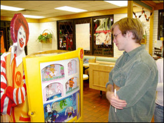 Meanwhile, Spencer ponders the navel of the universe while looking at the Happy Meal toys.