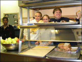Food service is in action, as Leigh, Mary, and myself strike a pose for the camera. The sequence was tray, plate, soup, sandwich, cheese, dessert, etc. Only complaint: the little plastic gloves didn't fit very well.