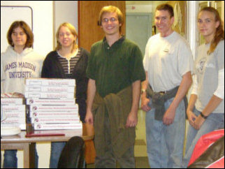 Catherine, Nicole, Spencer, Mark, and Leigh strike a pose with the pizza that the residents of Sojourner House and ourselves devoured like it was going out of style.