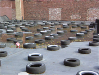 A strange sight! The building next to Sojourner House had tires placed all over the roof.