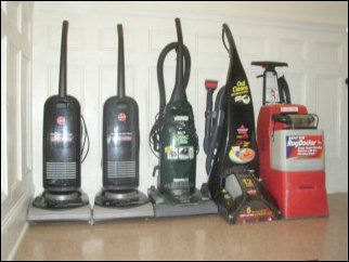 This was some of our arsenal, as you see three vacuums, Kathleen's steamer, and a Rug Doctor. Add to this about three more rug doctors and one more vacuum, and you've got it.