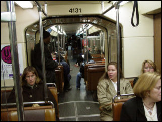 """The T uses articulated light rail vehicles. Each light rail vehicle is two """"cars"""", connected by a hinge in the middle (I'm oversimplifying, but you get the idea). Additionally, the lights go out for a few seconds inside the cars when the trains change wires. Only the blue lights stay on during these changeovers."""