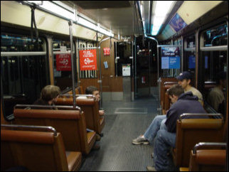 "The T uses articulated light rail vehicles. Each light rail vehicle is two ""cars"", connected by a hinge in the middle (I'm oversimplifying, but you get the idea). Additionally, the lights go out for a few seconds inside the cars when the trains change wires. Only the blue lights stay on during these changeovers."
