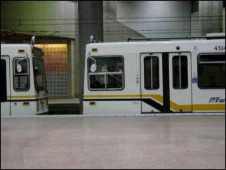 Inside some of the underground stations, passengers disembark, and trains sit idle on a side track.